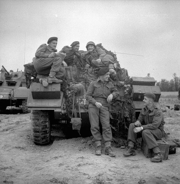 Photo of Piled on a Sherman Tank
