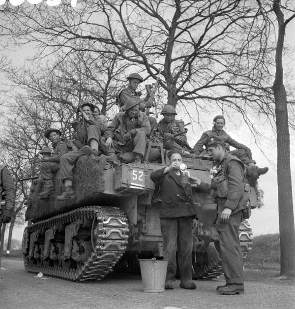 Photo of Riding on a Sherman Tank