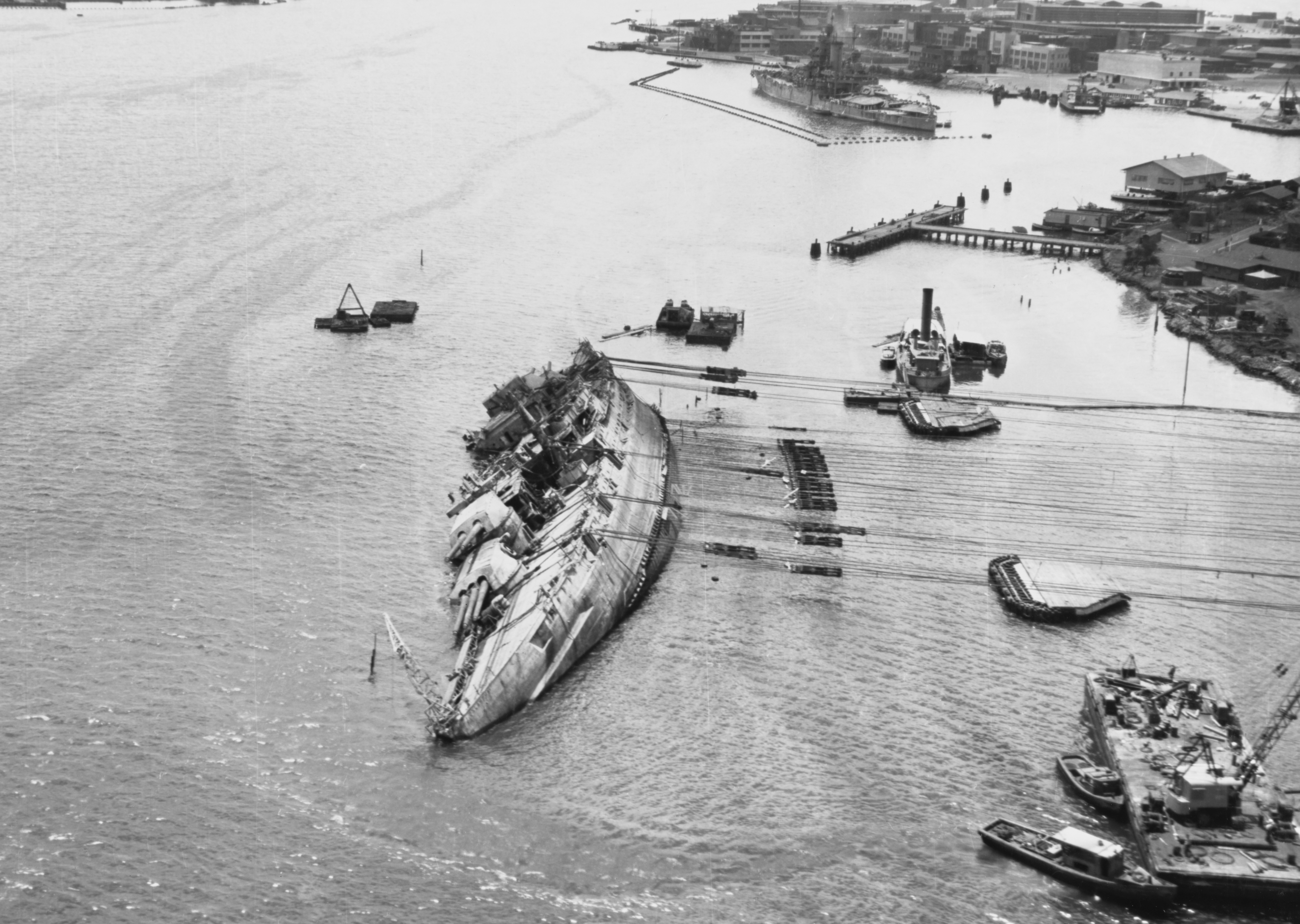 Photo of USS Oklahoma being righted