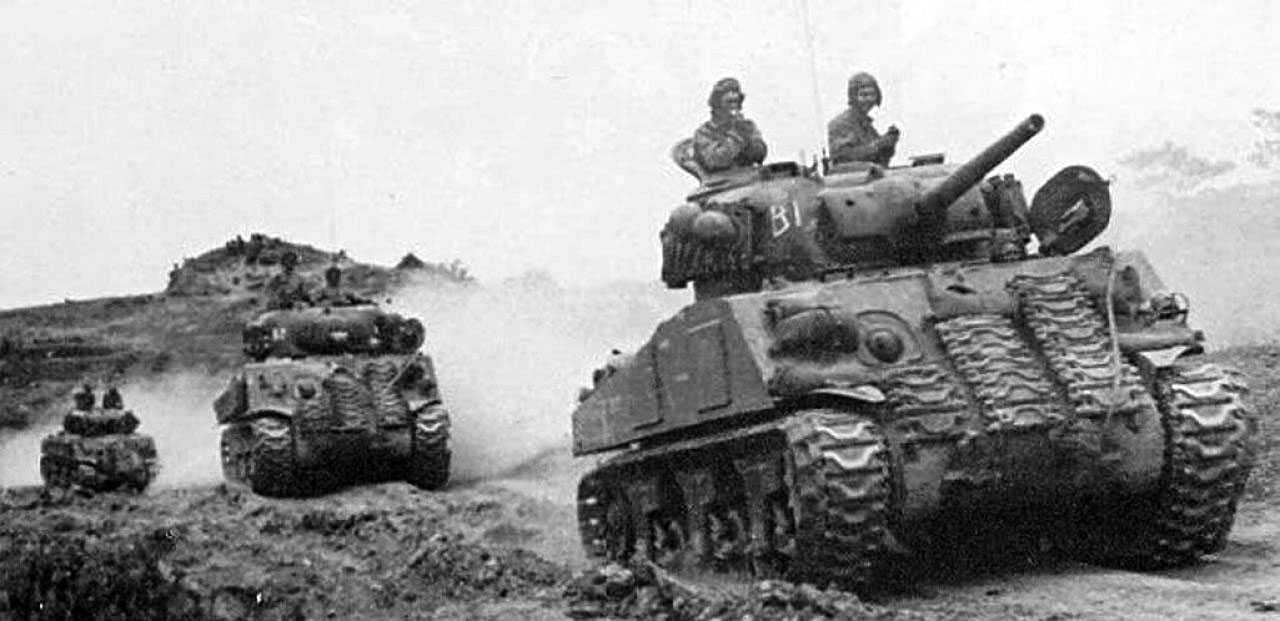 Photo of Advancing Column of M4 Shermans