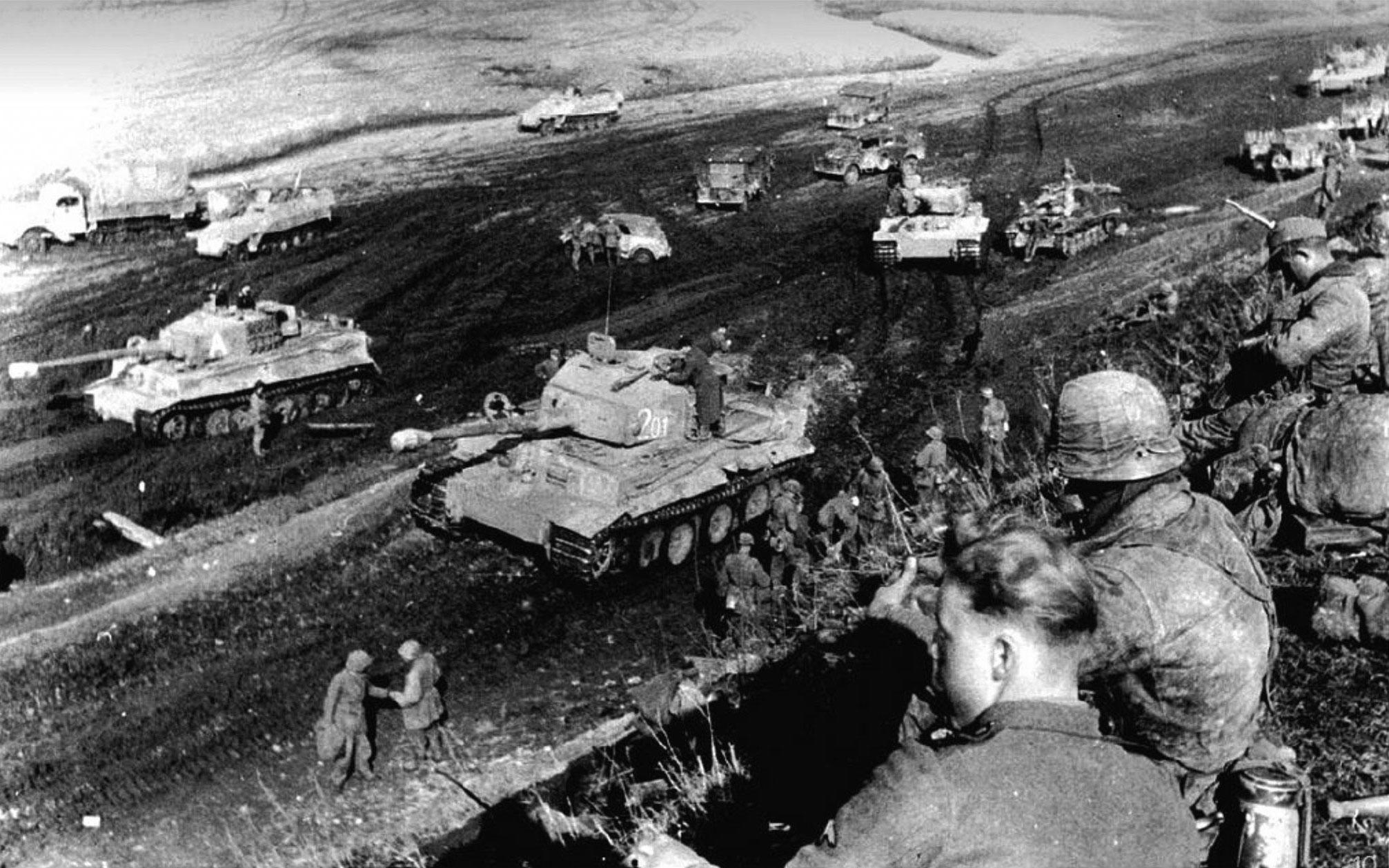 Photo of German Vehicles Navigate A Mud Pit