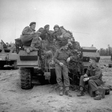 Piled on a Sherman Tank