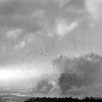 Anti-aircraft shell bursts blot the sky