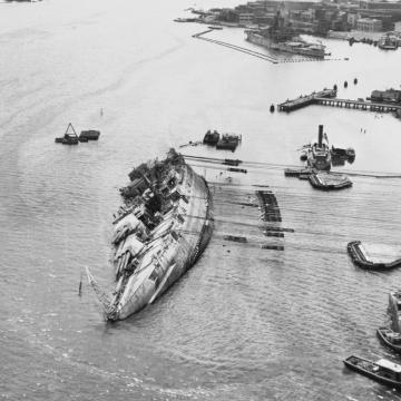 USS Oklahoma being righted