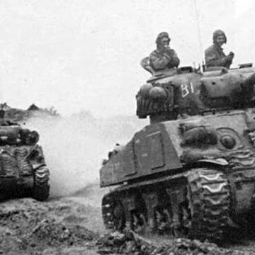 Advancing Column of M4 Shermans